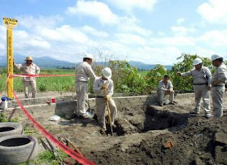 Pemex workers inspect an illegal pipeline tap