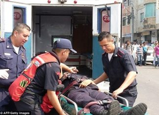 A wounded Venezuelan police officer
