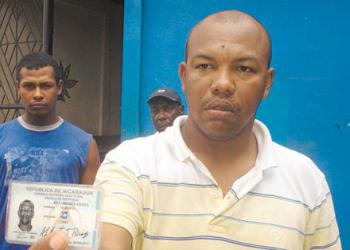 Carmona holding his fake Nicaraguan ID in 2009