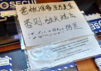 An extortion note left by a Chinese mafia
