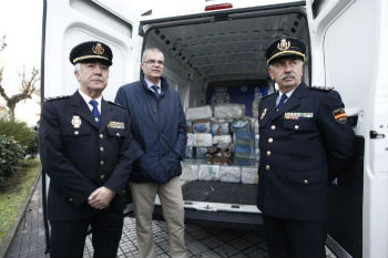 Spanish authorities with seized cocaine