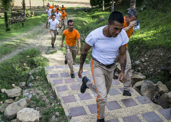 Inmates doing exercise inside Acacías prison