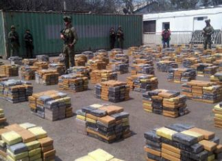 Police guard the six tons of cocaine seized in Barranquilla