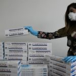 Chilean authorities with confiscated contraband cigarettes