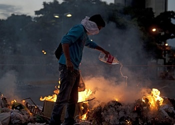 A demonstrator in Venezuela, the country's with the world's worst