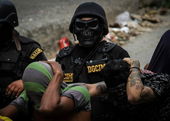 A security officer wears a skull mask during an OLP operation