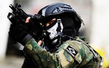 Brazil soldier on patrol wearing a skull mask