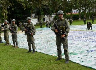 Colombian security forces next to the 12 tons of cocaine seized