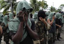 """Members of """"Los Rastrojos"""" surrendered their weapons ©AP/Luis Benavides."""
