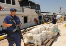 US Coast Guard officers guard a seized drug shipment