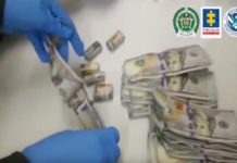 Authorities in Colombia process the dirty money uncovered in the operation