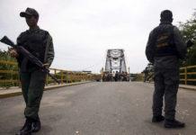 Venezuela's National Guards stand guard at the closed international bridge La Union, on the border with Colombia, at Boca de Grita